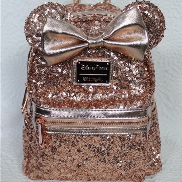 314762cd7e6 Disney Handbags - Disney parks loungefly rose gold sequin backpack
